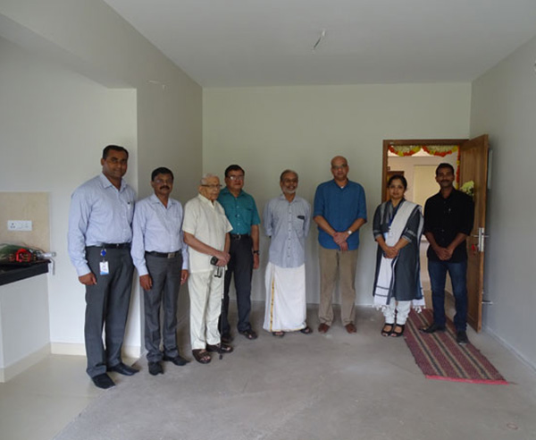 Our team with Mr. Unnikrishnan & family of apartment B 5 in Crescent Aster after handing over.