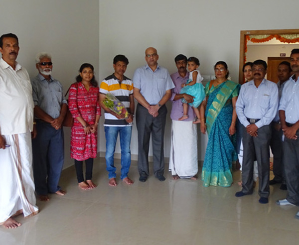 Our team with Mr. Amal Kumar & family of apartment B 7 in Crescent Aster after handing over.