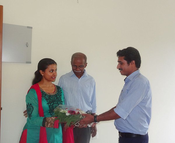 Our project Engineer greeting Ms.Swapna Praveen of apartment D 7, Crescent Iris during handing over ceremony.