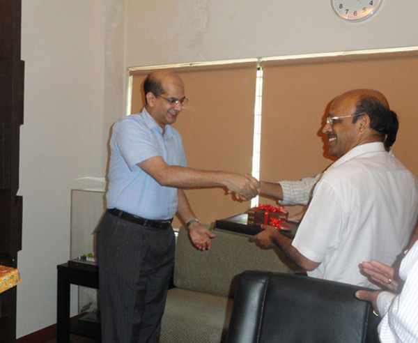 Keys being handed over to Mr. N P Rajan of apartment no A 7