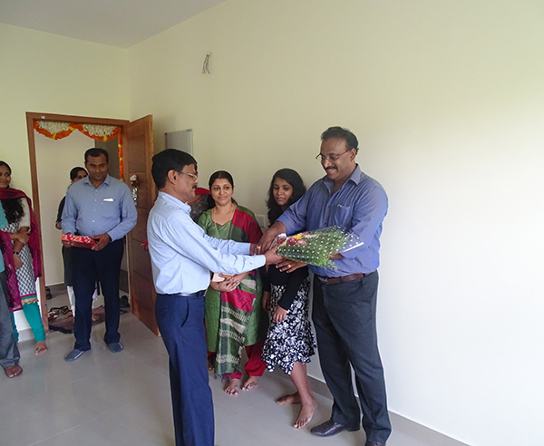 Our G M Projects greeting Mr.Perumthodi Ajith Kumar of apartment D 5, Crescent Iris during handing over ceremony.