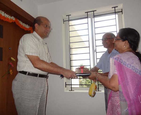 Keys being handed over to Mr & Mrs Nandakumar of apartment no. A 7
