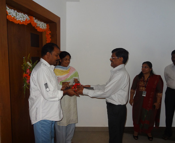 Keys being handed over to Mr & Mrs Priyesh Kumar of apartment no. B 5