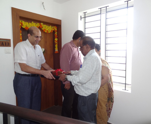 Keys being handed over to Dr. Santhakumar of apartment no. A 13