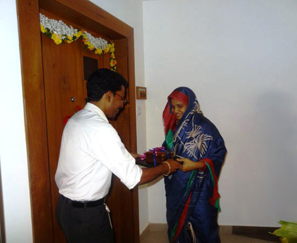 Keys being handed over to Mr. Yoonus Salim of apartment no. B 10