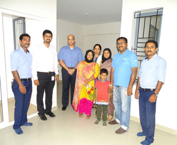 Our team with Ms. Katheeja & family of apartment A 1 in Crescent Aster after handing over.