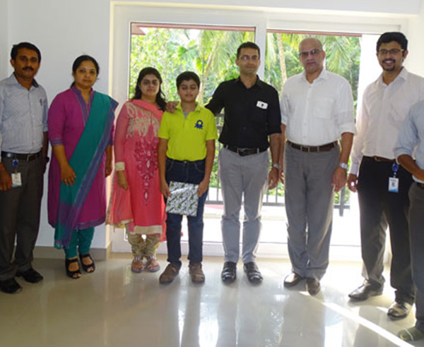 Our team with Mr. John Mathew & family of apartment B 1 in Crescent Aster after handing over.