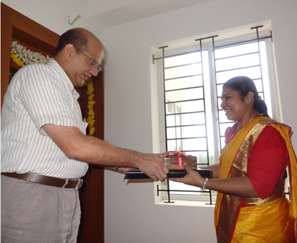Keys being handed over to Ms. Sherly.P of apartment no. A 9