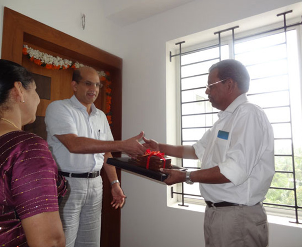 Keys being handed over to Mr. Cyriac of apartment no.A 8