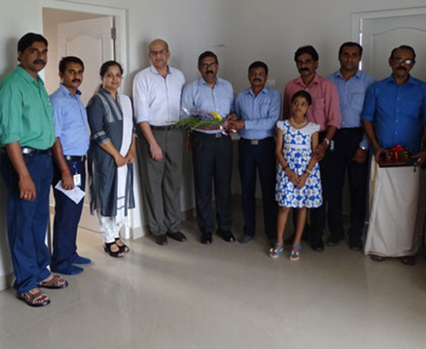 Our team with Mr. Muraleedharan & family of apartment C 8  in Crescent Aster after handing over