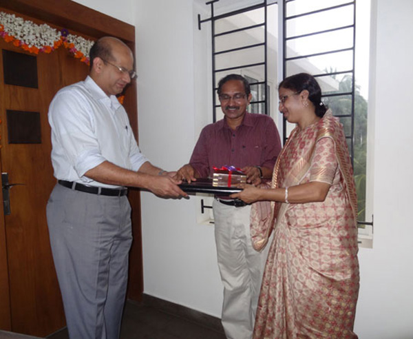 Keys being handed over to Mr.& Mrs. P.C.Basheer of apartment no. A 4