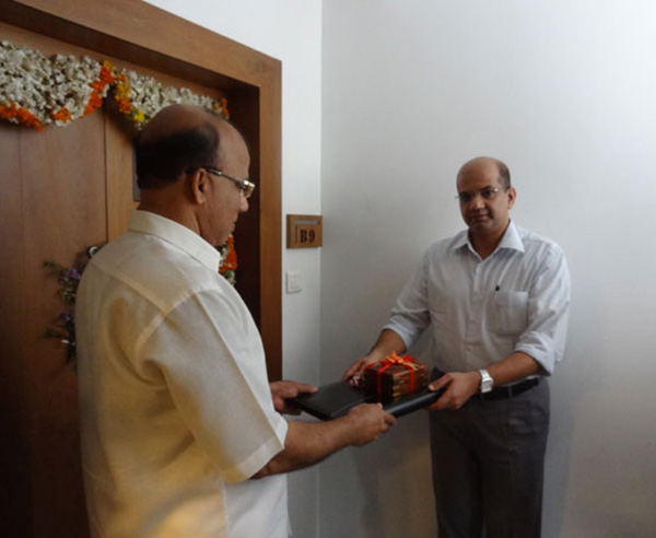 Keys being handed over to Mr Abdurahiman of apartment no.B 9