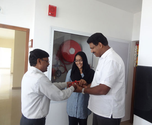 Keys being handed over to Mr. Abdu Rahiman of apartment C 11