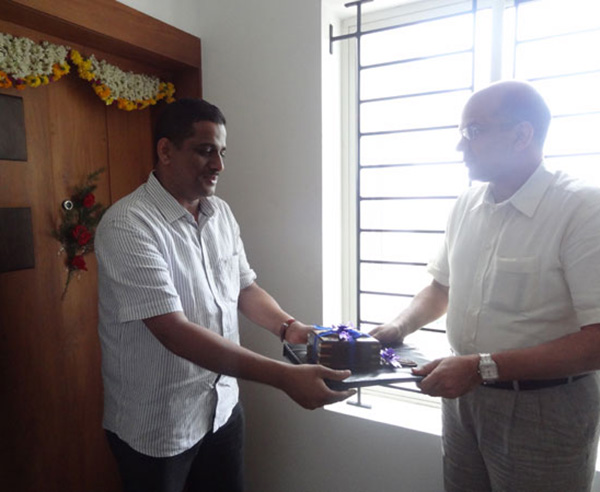 Keys being handed over to Mr.Azeem.V.P of apartment no. A 11