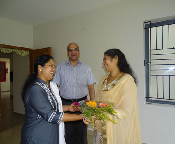 Our Relationship Officer greeting Ms. Asha Nair of apartment B 9 in Crescent Aster during handing over ceremony.