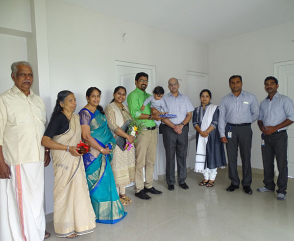 Our team with Dr. Renjith & family of apartment C 6 in Crescent Aster after handing over.