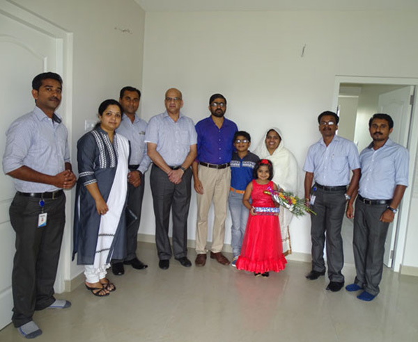 Our team with Mr. Abdul Rajib & family of apartment C 5 in Crescent Aster after handing over.