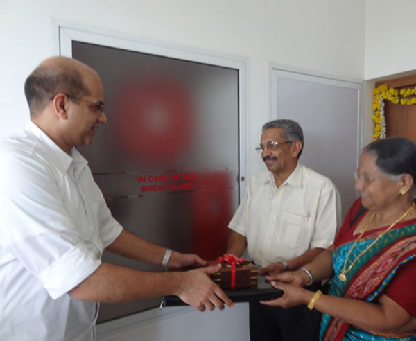 Keys being handed over to Mr. & Mrs. T Balakrishnan of apartment C 8