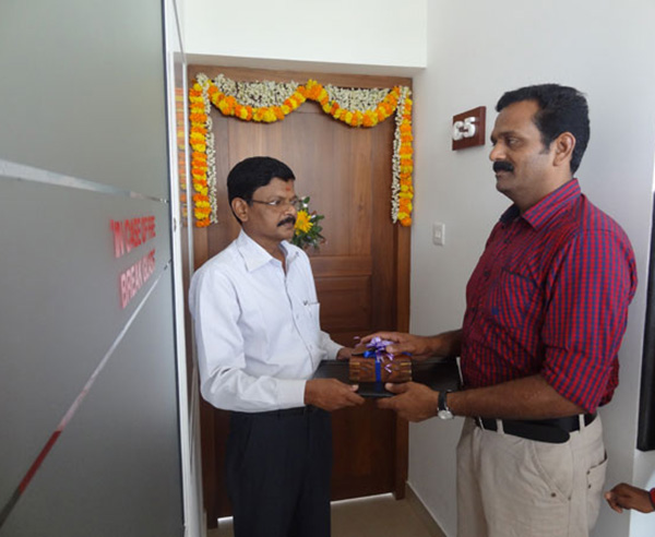 Keys being handed over to Mr. M G Rameshan, apartment no C 5