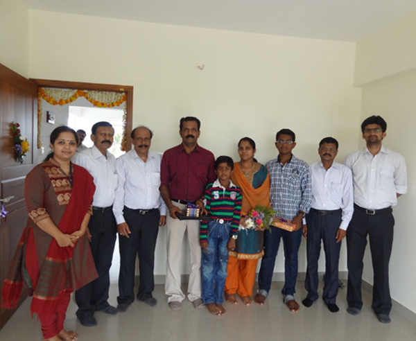 Mr. Rameshan & family, of apartment no C 5 in Crescent Mansa during handing over ceremony