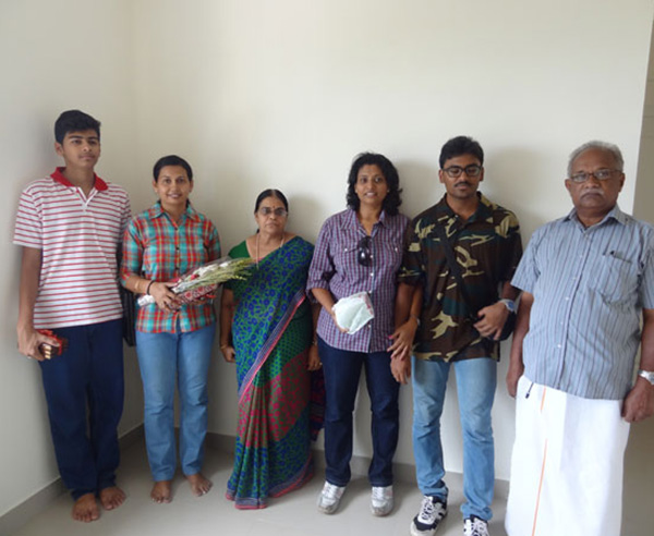 Ms. Reena Balakrishnan & family , of apartment no B 7 in Crescent Mansa during handing over ceremony