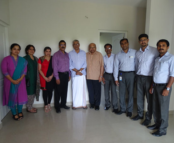 Our team with Mr. Sasikumar N  P & family of apartment C 4 in Crescent Aster after handing over.