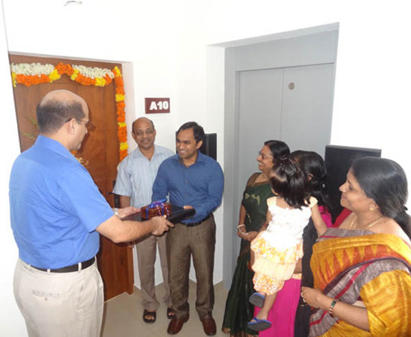 Keys being handed over to Mr. Ranjeev Rajan of apartment no A 10