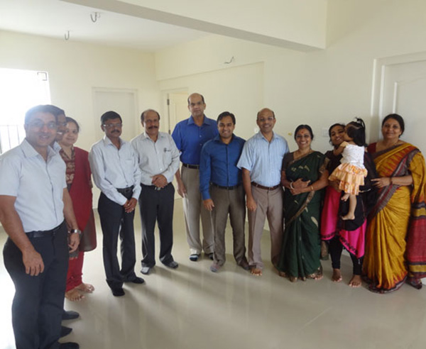 Mr. Ranjeev Rajan & family , of apartment no A 10 in Crescent Mansa during handing over ceremony