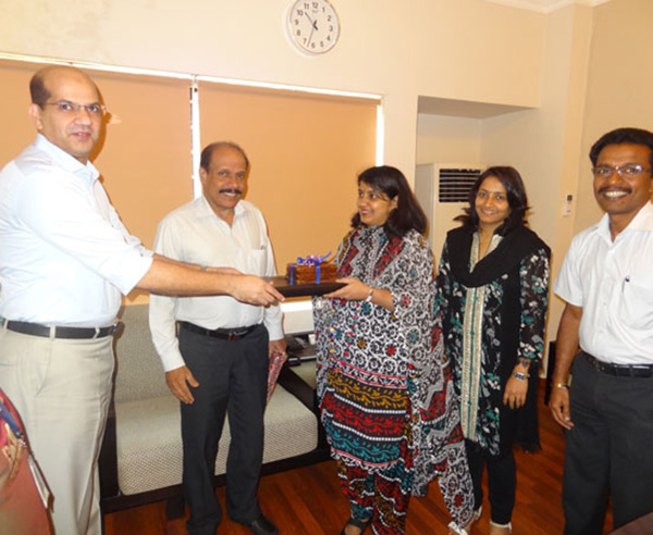 Keys being handed over to Ms. Sheeba Rashid, apartment no. A 5.