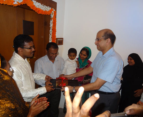 Keys being handed over to Mr. Mohammed Rassal & Family, apartment no. B 6