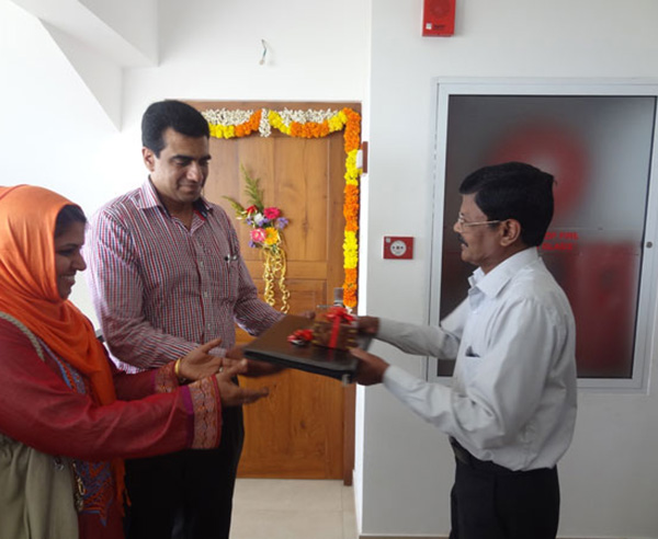Keys being handed over to Mr. & Mrs. Bava Usman  of apartment no B 11