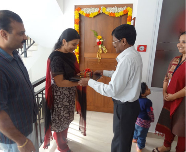 Keys being handed over to Ms. Janitha of apartment no B 2