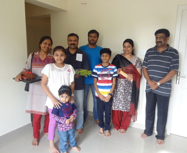 Ms. Janaitha and Mr.Anil Kumar & family , of apartment no B 2 in Crescent Mansa during handing over ceremony