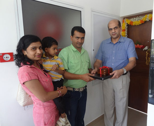 Keys being handed over to Mr. & Mrs. Susanth S of apartment no C 3