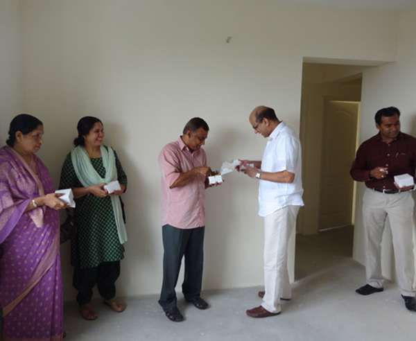 Mr. Jaleel & family, of apartment no B 10 in Crescent Mansa during handing over ceremony