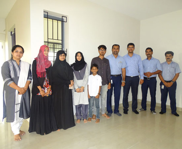 Our team with Ms. Ramla  & family of apartment A 7 in Crescent Aster after handing over