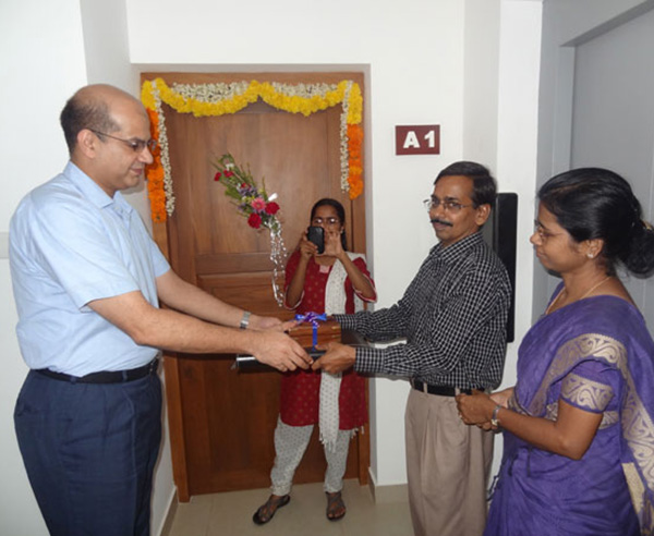 Keys being handed over to Dr. Vasudevan and Dr. Anandavally , apartment A 1
