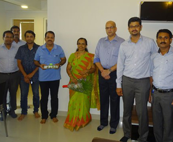 Our team with Ms. Sreelatha & family of apartment D 6 in Crescent Aster after handing over