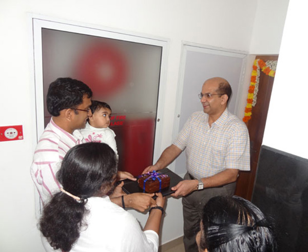Keys being handed over to Mr. & Mrs. Ashiervad Sivadas of apartment no C 4
