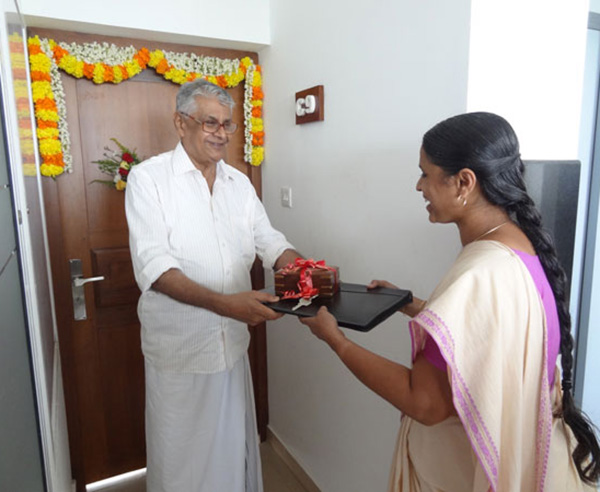 Keys being handed over to Ms. Sindhuja S of apartment no C 9