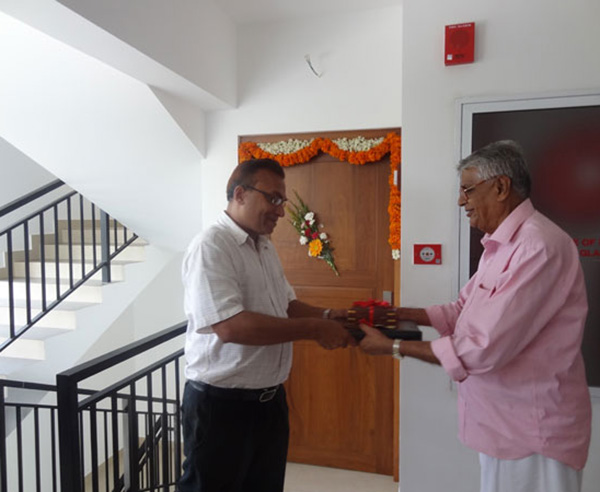 Keys being handed over to Mr. Azeez  of apartment no B 4