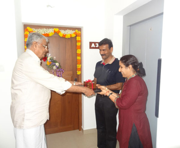 Keys being handed over to Mr. & Mrs. Pramod Kumar Pooleri  of apartment no A 3