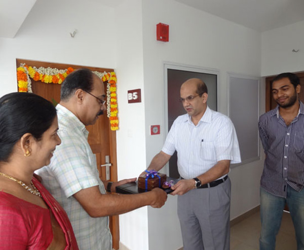 Keys being handed over to Mr. Abdul Jamal of apartment no B 5