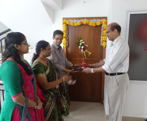 Keys being handed over to Mr. & Mrs. K V Muraleedharan  of apartment no B 3