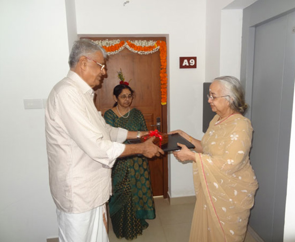 Keys being handed over by  Mr. C  V. Musthafa (Partner - Crescent Builders) to Ms. Lakshmi on behalf of Dr. Srikumar & Dr. Preetha of apartment A 9