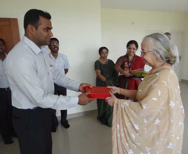 Ms. Lakshmi of apartment no A 9 in Crescent Mansa being greeted by our GM Sales Mr.Savin.