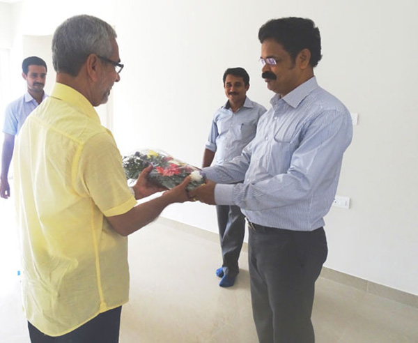 Our Asst. Manager - Administration greeting Mr.Mohammed Iqbal of apartment D 2, Crescent Aster during handing over ceremony.
