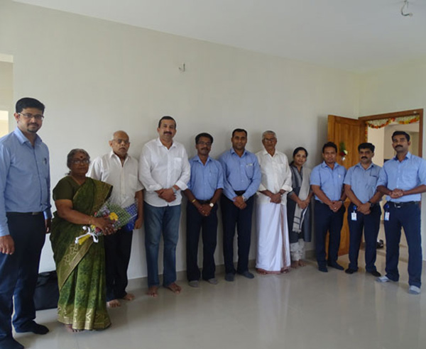 Our team with Mr. Surej & family of apartment D 10 in Crescent Aster after handing over