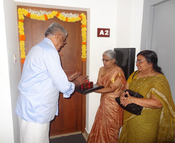 Keys being handed over to Ms. Lathika of apartment A 2