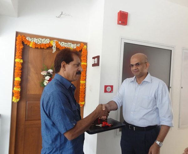 Keys being handed over to Mr. K Mohammed Kutty of apartment B 1